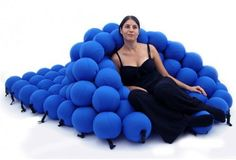 The Feel Seating System Deluxe is the ultimate office chair. It's a sheet of 120 fabric balls linked with elastic strands. Buckles on the edges let the user ...