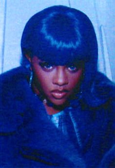Lil Kim.... started the different color wigs then Nikki followed...