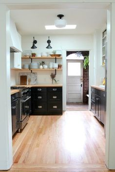 I like the black cabinets with the open shelves above. Not sure about the all white walls, they're kind of stark.