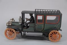 Vintage tin toy wind up transport truck with driver and rubber tires ht. 8in., lg. 16in. - Realized Price: $4,887.50