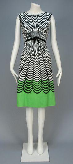 DAVID GOODSTEIN OP ART DAY DRESS, 1960s Sleeveless ribbed white cotton printed with black scallops, the lower skirt black on lime green, black velvet belt.
