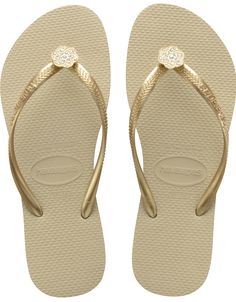 The Slim Crystal Poem features a sparkling floral embellishment on a slim metallic strap for added glamour. A tonal Havaianas logo and our signature textured footbed provide style and comfort.   Thong style   Cushioned footbed with textured rice pattern and rubber flip flop sole   Made in Brazil
