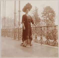 Empress Alexandra on a balcony of one of the imperial palaces.  Note the cross around her neck.  She would lean on her faith for strength during the trials that would come.