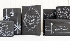 Too late for Christmas, but so cute! Chalkboardpresents - black wrapping paper and white paint marker