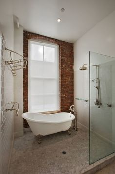tub in shower, exposed brick