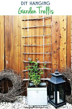 Make this DIY Hanging Garden Trellis for your climbing vines! This simple and rustic trellis can be made with twigs from your yard, and some garden twine. Makes a pretty addition to your garden!