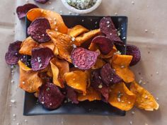Use a mandoline to get super-thin cuts of potato and beets before frying them in vegetable oil.