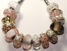 This collection of light shell pink and white glitter Trollbeads is from a customer.  I always keep an eye out so she can add to it.  The shell pink armadillo is breathtaking.