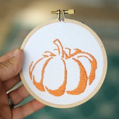 Simple and yet unique, this pumpkin embroidery works with negative space and uses just one simple stitch.