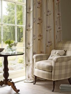 Colefax And Fowlers Louise Linen (drapes and pillow), and Marldon Stripe (chair) #colefaxandfowler #textiles #fabrics