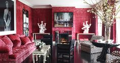 Thomas Britt, San Francisco, California In the San Francisco house of Alexis and Trevor Traina, New York-based interior designer Britt used a ravishing red damask — on both the walls and the couch — to serve as a backdrop for the couple's contemporary art collection, which includes works by, from left, Hiroshi Sugimoto, John Baldessari and Jackie Nickerson.