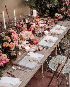rich tablescape with marble chargers juicy pomegranates nutty cheeses and drippy wax tapers and did we mention this is in Italy? Yeah it doesn't get any more perfect than this. More on #ruffledblog! photo @elisabettalillyred planning styling and stationery @themarthysvintagegarden floral design @chiaraspertifloralevents