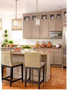 frosted glass top cabinets + pendants + island table + taupe kitchen palette