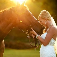 Dreamy bridals among a horse pasture flooded with golden light.