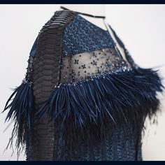 Faux feather and snake skin details to give it an exotic touch