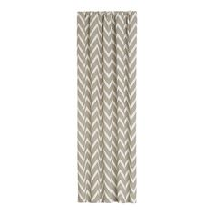 Cream-and-white curtain panels in a classic chevron bring an understated graphic touch to the windows. Teramo curtain panel, $79.95, Crate & Barrel.