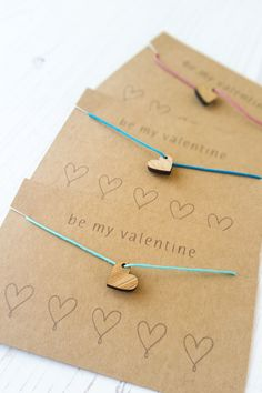 Sweet bamboo heart charms make these friendship bracelets perfect for Valentine's Day. Check out the DIY tutorial.