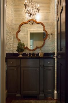Design group Lucy and Company featured Gilded Age 5768 Breakers Blue in the powder room of a client's home.