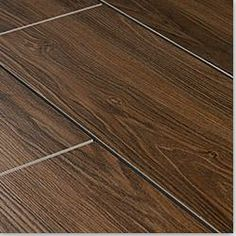 Wood grain ceramic tile - problem solved found durable easy maintenance kid and per friendly flooring for my main living space! This is genius!