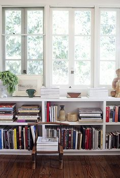 built-in shelves under windows in formal space?
