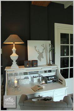 Dark walls, white furniture and door