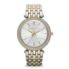 This beautiful Michael Kors MK3215 womens analog quartz watch features a silver dial, glitz bezel, and a two tone stainless steel case and band.