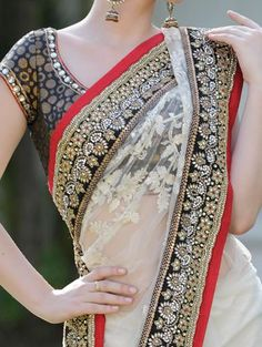 nice blouse shape and detail on the sari border, though the black is not good for a wedding. From mokshaaworld.com.