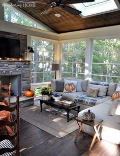 Fall decor in the sunroom~warm and inviting.