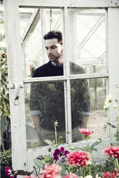 Good Lord he's in a greenhouse... Aidan Turner  Aside from being Aidan Turner, the hilarious caption made me pin it