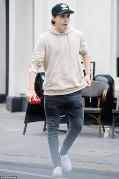 Brooklyn Beckham wearing Adidas Original Thrasher Chain Snapback and Vans Classic Slip-on in White