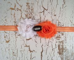 Texas Longhorns themed headband perfect for game day. Orange and white flowers…