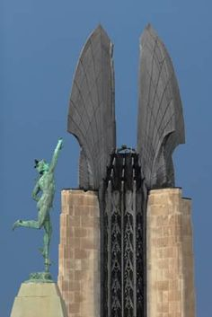 Rochester, New York:  The statue to Mercury atop the Lawyers Cooperative Extension building and the Wings of the Times Square Building.  Mercury and Wings II by Sheridan Vincent