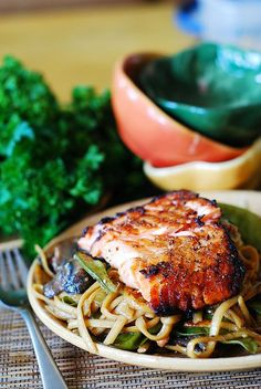 Asian honey-soy salmon and noodles with mushrooms, snow peas in