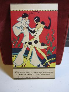 Gorgeous art deco 1920's-30's Christmas Card pierrot dancing with beautiful deco lady with pom poms on her dress and shoes.