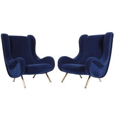 Pair of Senior Lounge Chairs by Marco Zanuso | From a unique collection of antique and modern lounge chairs at http://www.1stdibs.com/furniture/seating/lounge-chairs/
