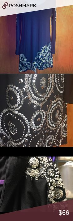 Large blingy black thick above knee dress or tunic Super springy material. Hard for me to list this as I've held onto it for 1 year but still haven't had a chance to wear it....so it's time to let go. Beautiful sequins and beading adorn the bottom and sleeves of the dress. It is 93% Rayon and 7% Spandex so it's super comfortable & flattering yet looks classy & expensive. Boutique bought! Faith Dresses Midi