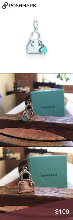 Tiffany & Co. Handbag Charm Charm in sterling silver with Tiffany Blue enamel finish. The small Tiffany blue heart broke off when I first received it, and I had it soldiered back on. It is extremely secure now. Comes with original Tiffany's box and from a smoke free home. Tiffany & Co. Jewelry