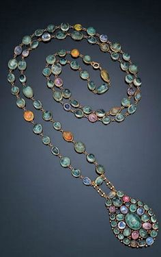 CABOCHON EMERALD, SAPPHIRE, PINK SAPPHIRE AND FIRE OPAL PENDANT NECKLACE, LOUIS COMFORT TIFFANY FOR TIFFANY & CO. mounted in gold, circa 1918.