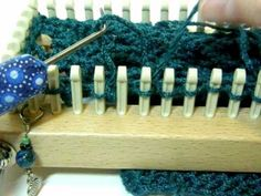 Loom Knit - How to do a Chain Lace Stitch on a Knitting Loom.  Makes lacy looking chains with no messy connecting threads.  From GettinItPegged.
