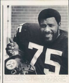 Mean Joe Greene with the 4 Super Bowl rings he won with the Steelers