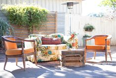 Vintage flower couch, Orange chairs, Cowhide rug, Crate coffee table P. Table Pc, Orange Chairs, Outdoor Furniture Sets, Outdoor Decor, Tree Lighting, Cow Hide Rug, Twinkle Lights, Vintage Flowers, Crates