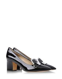 Black patent leather closed toe shoes by Pollini. Square heel and silver buckle.