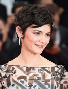 Audrey Tautou offset her embellished monochrome dress with chic diamond drop earrings by Chaumet.