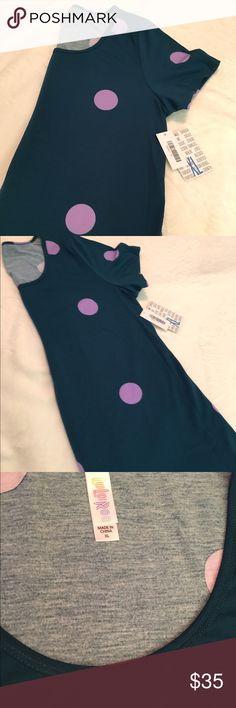 LuLaRoe XL Classic T Playful dark teal green with large lavender dots LuLaRoe XL Classic T.  Made in China.  96% polyester 4% spandex blend fabric.  Smoke-free, cat-friendly home. BNWT LuLaRoe Tops Tees - Short Sleeve