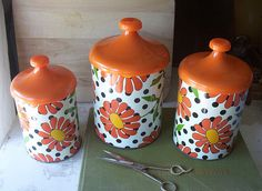 This is a kitchen canister set that has three different sized tins with matching lids. I think there might have been more to the set, but this is all that I have. The tins fit inside each other really well, but the lids can not be nestled because of  Be sure to see our awesome home decor items at www.CreativeHomeDecorations.com