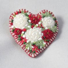 "Susan Bentley (@lynwoodcrafts) on Instagram: ""Embroidered and felted felt heart brooch with white roses and red anemones hand stitched by…"""