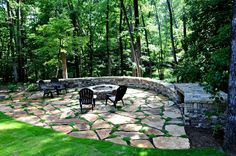 A quiet place to relax 'away from it all'. Custom fire pit with flagstone patio. We installed a large retaining wall to transform an inaccessible backyard slope into a private outdoor space nestled on the edge of a wooded backdrop. - Be A Gardening Star No Grass Backyard, Sloped Backyard, Backyard Seating, Backyard Fences, Sloped Yard, Backyard Pavers, Backyard Bbq, Pergola Patio, Fire Pit Area