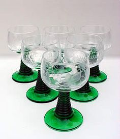 """German Wine Glasses - FOUND SOME FOR A GREAT DEAL!!!! SOME CLEAR, SOME ETCHED W/ GRAPE LEAVES, SOME W/ THE GERMAN """"MUST FILL TO THIS LINE"""" GOLD LINE AND EVEN SOME ITTY BITTY ONES!!!"""