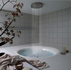 Dreamy, yes, but ruined with the reality of slipping? No handles? Leaning over the edge to grab your toiletries (provided you remembered to bring them to the tub)?