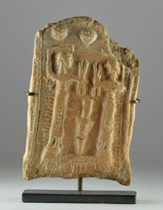 Mesopotamian baked clay plaque, Bronze Age, 3rd-2nd millenium B.C.With two standing figures filling amphora with corns,  10.6 cm high. Private collection